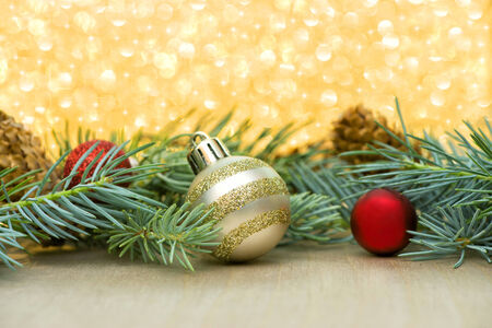 red and gold christmas ornaments with spruce boughs on a sparkle background with stars stock - Gold Christmas Ornaments