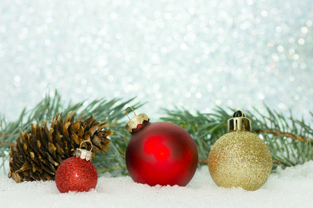 boughs: Red and gold Christmas ornaments with spruce boughs on a sparkle background.