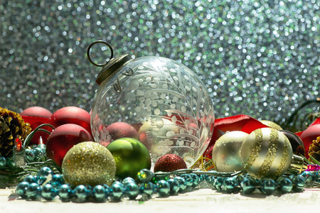 christmas beads: Antique clear cut glass Christmas ornament with lights, spruce, beads, and ribbon.