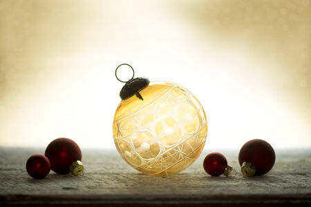 kugel: Antique amber crystal cut glass Christmas ornament.
