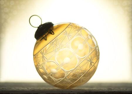 kugel: Antique amber crystal cut glass Christmas ornament.