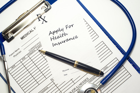 Prescription to apply for health insurance with medical record and stethoscope. Stock Photo