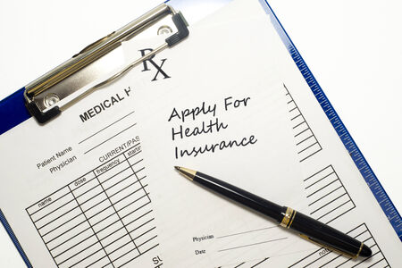 Prescription to apply for health insurance with medical record and stethoscope. 版權商用圖片