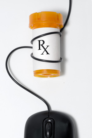 Prescription bottle with mouse cord wrapped around it. photo