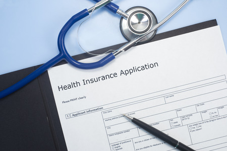 Application for health insurance with stethoscope.