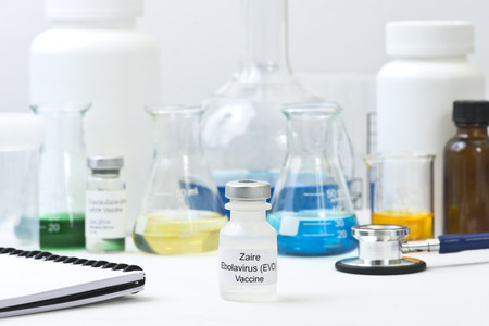 Ebola Zaire vaccine with laboratory research equipment. photo