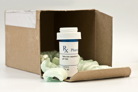 Mail order prescription with box and styrofoam peanuts. Stok Fotoğraf - 34751025