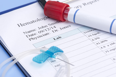 hematology: Hematology report with IV needle and blood collection tube. Editorial