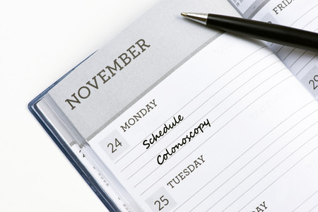 Appoinment book with schedule colonoscopy reminder.