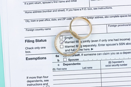 jointly: Wedding rings with United States tax form 1040.