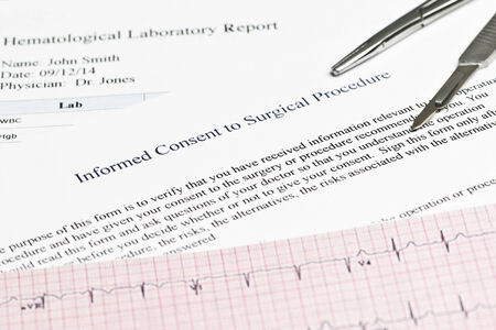 informed: Informed consent for surgical procedure form with hematology report and electrocardiograph. Stock Photo
