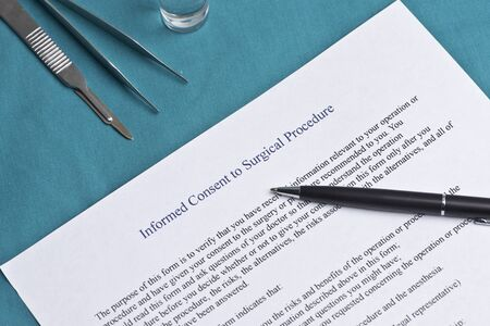 informed: Informed consent for surgical procedure form on surgical table. Stock Photo