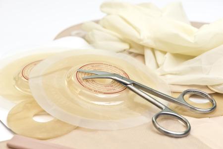 ileum: Ostomy scissors, wafers, bags and supplies. Stock Photo
