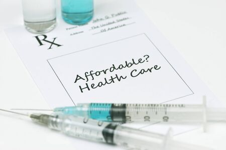 affordable: Affordable health care prescription with syringes and vials.
