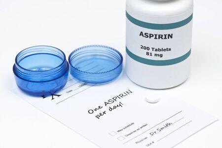 aspirin: Daily aspirin tablet with aspirin bottle, container, and prescription.