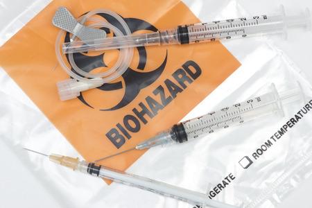 phlebotomy: Biohazard waste bag with used syringes, and IV needles.