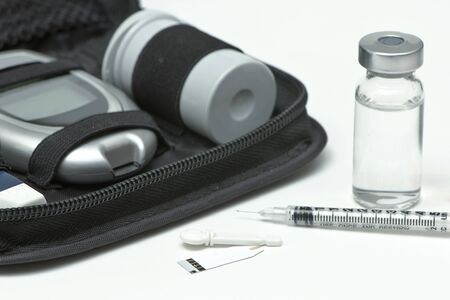 Insulin vial, syringe, lancet, strip and diabetic travel kit case. photo