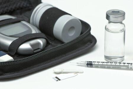 diabetes needles: Insulin vial, syringe, lancet, strip and diabetic travel kit case.
