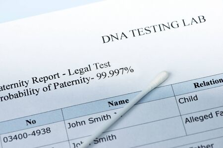 Paternity test results with lab sample swab.