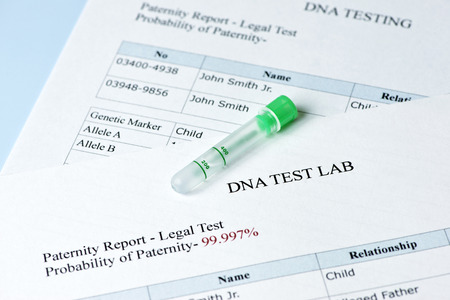 paternity: Paternity test results report with lab sample test tube.