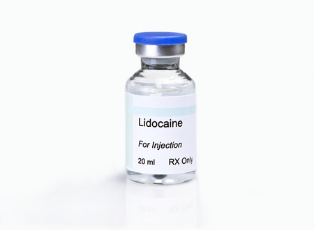 Glass vial of lidocaine injection solution with on white background.  Label is fictitious, and any resemblance to any actual product is purely coincidental.