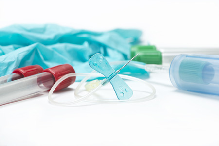 catheter: Blue safety catheter with blood collection tubes, gloves, and holder.