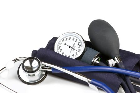sphygmomanometer: Stethoscope and blood pressure cuff on white background.