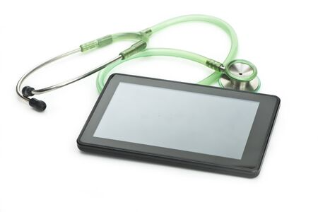 computing device: Personal computing device with stethoscope on white background. Stock Photo
