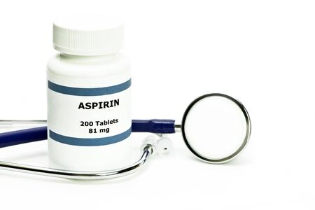 Aspirin bottle with two pills and stethoscope on white with copyspace. Label is fictitious, and any resemblance to any actual product is purely coincidental.