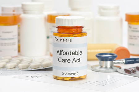 fictitious: Affordable Care Act pill bottle with prescription and medical supplies.  Labels and all information contained therein are fictitious.