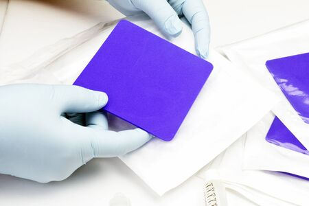 bacteriostatic: Nurse prepares bacteriostatic foam wound dressing for use.