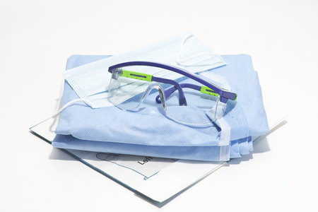Gloves, mask, gown and safety glasses for personal protection during surgical procedures.