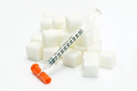 insulin syringe: Diabetes insulin syringe with white sugar cubes. Stock Photo