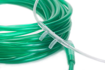 Nasal cannula with green pxygen tubing.