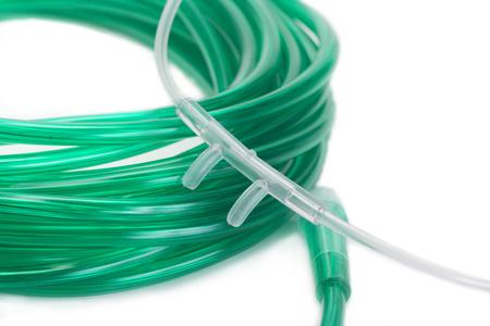tubing: Nasal cannula with green pxygen tubing.