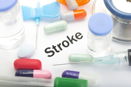 Stroke concept photo with medical supplies and medication. 스톡 콘텐츠