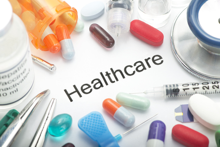 fictitious: Healthcare concept photo with medication and medical supplies.  Label is totally fictitious (fake). Stock Photo