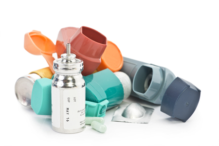 Colorful asthma inhalers and asthma medication on white background. Albuterol sulfate is a common non trademarked medication name.