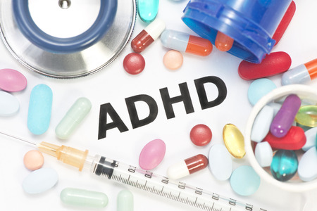ADHD concept photo with stethoscope and medication.