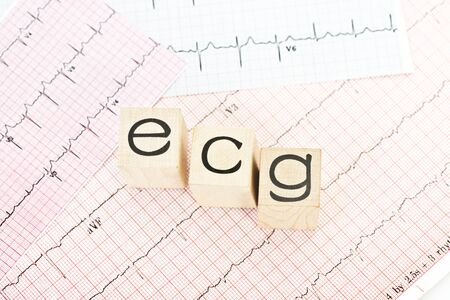 Electrocardiogram ecg block letters on electrocardiograph print out.