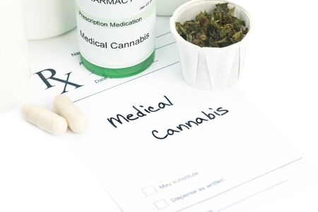 hypothetical: Hypothetical medical marijuana prescription with pills and bottle.  Label and document are ficitious. Stock Photo