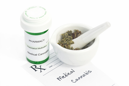 fictitious: Medical marijuana in mortar with prescription.  Document is fictitious. Stock Photo