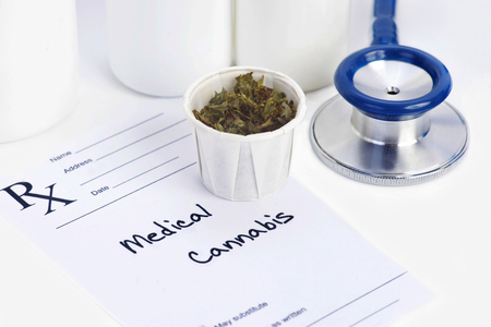dispensary: Medical marijuana in paper cup with prescription.  Document is fictitious. Stock Photo