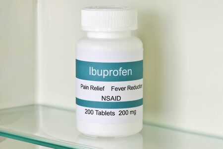 actual: Iibuprofen in medicine cabinet.  Labels are all fictitious and resemblance to any actual product is coincidental. Stock Photo