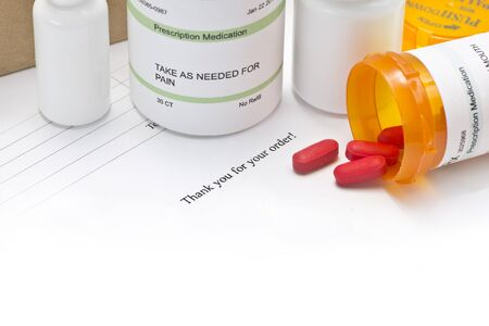 mail order: Mail order medications with invoice and copy space.  Serial numbers, dates and completely random numbers, labels are ficitious and created by the photographer. Stock Photo