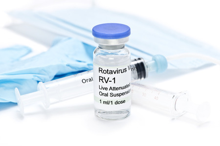 Rotavirus vaccine vial with syringes, gloves, and mask.  Serial numbers, dates are completely random numbers, labels are fictitious and created by the photographer.