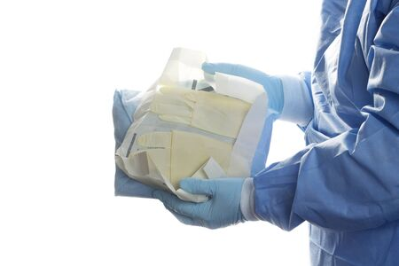 sterilization: Operating room technician opens sterile gloves for surgeon. Stock Photo
