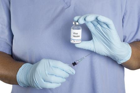 Nurse prepares to administer virus vaccine with syringe.