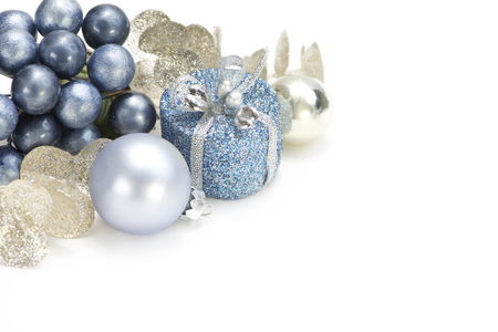 Blue, gold, and silver Christmas decorations on white background. Stock Photo