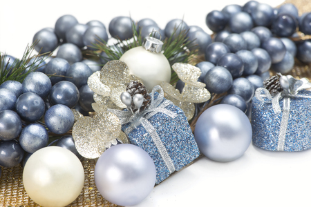 blue gold and silver christmas decorations on white background stock photo 63594693